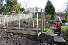 Gardener and part built polytunnel